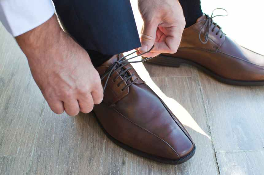 close up of man wearing shoes
